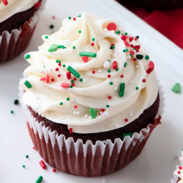 closeup of finished frosting on cupcake with sprinkles