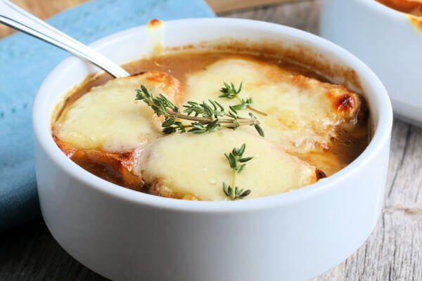 bowl of french onion soup with a spoon in it