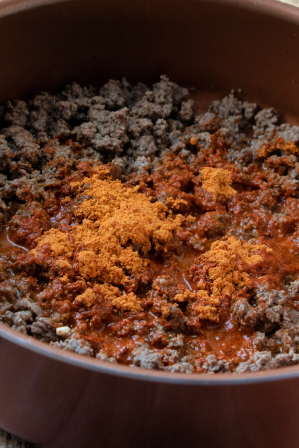 taco seasoning added to the cooked ground beef