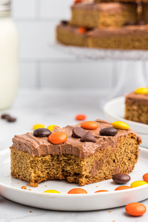 frosted peanut butter cookie bar on white plate with candies