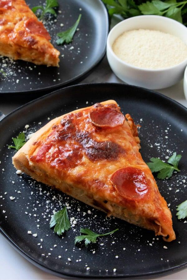 pizza slice on black plate
