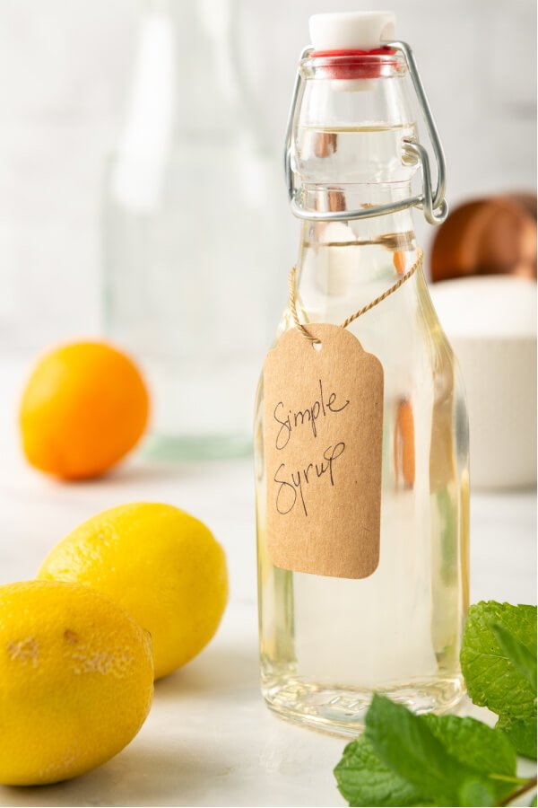 simple syrup in glass bottle