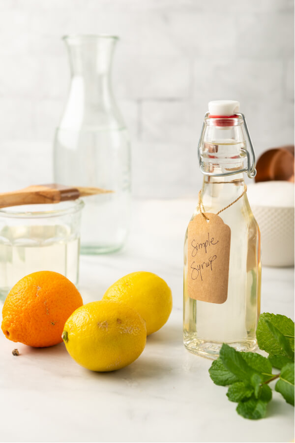 citrus and mint with a bottle of simple syrup