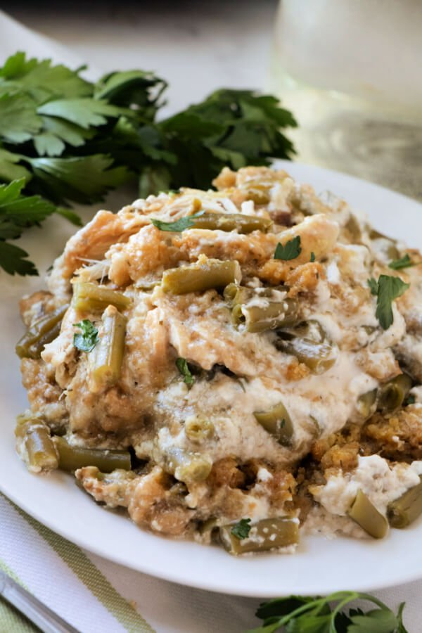 Slow Cooker Chicken Stuffing Green Bean Casserole on white plate