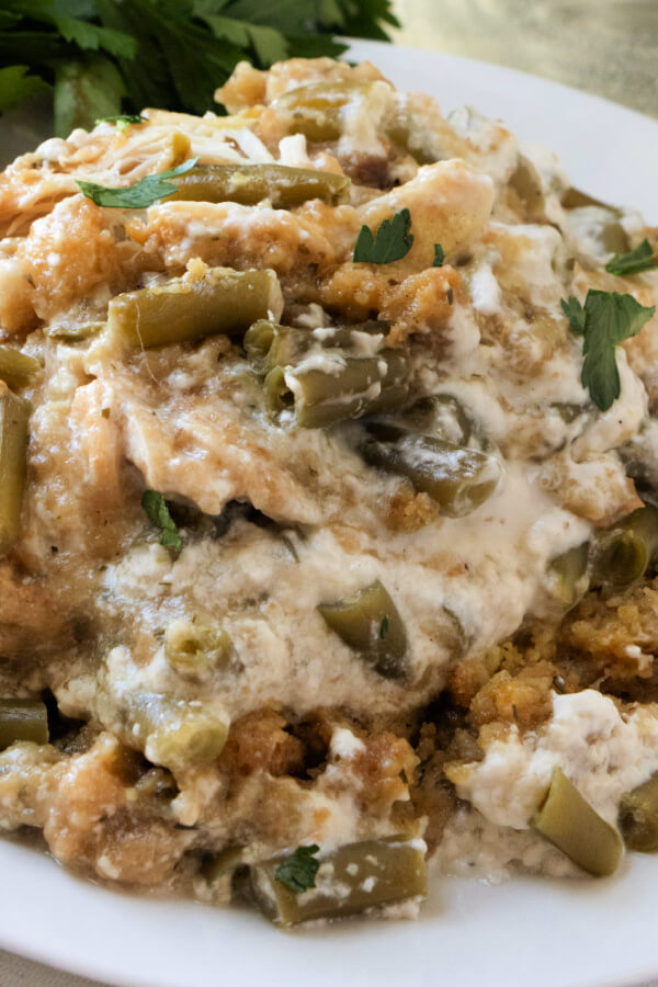 closeup chicken and stuffing casserole on white plate