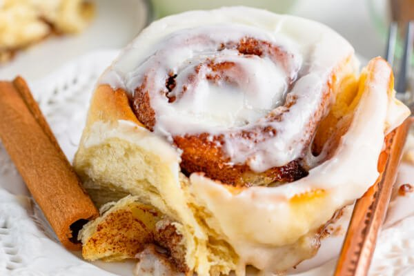 cinnamon roll with cream cheese icing on plate