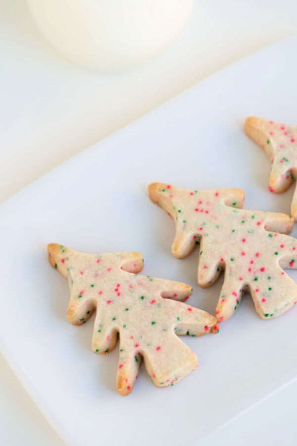 closeup of tree-shaped shortbread cookies on white plate