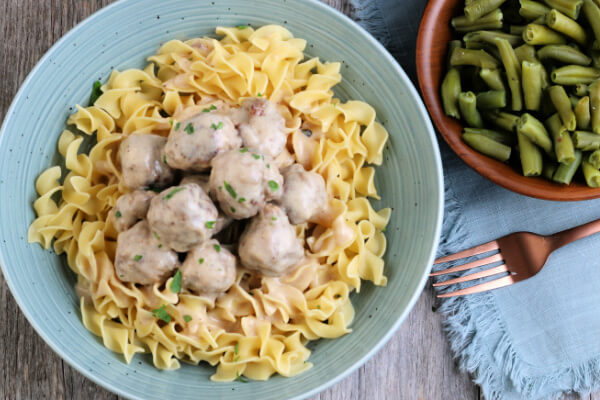 Swedish Meatballs over noodles with a side of green beans