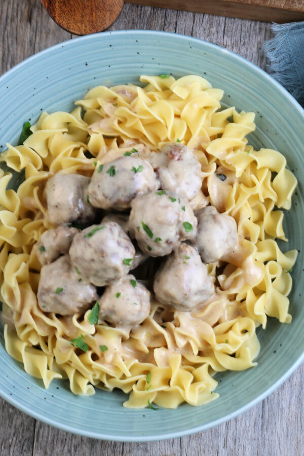 looking down onto a finished bowl of Swedish Meatballs in Gravy with wide egg noddles