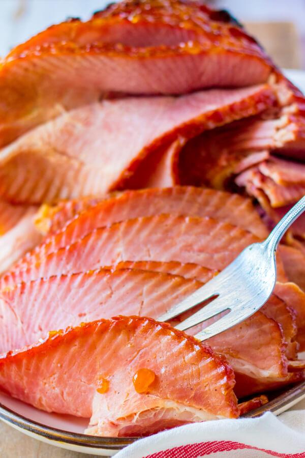 fork picking up a slice of ham