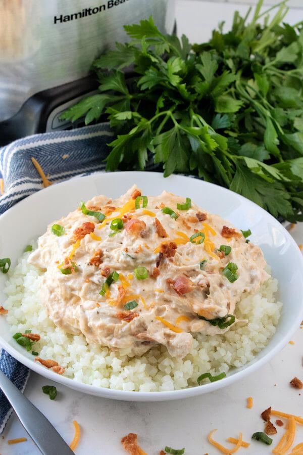 chicken mixture and cauliflower rice in bowl