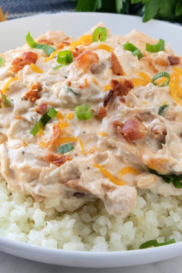 closeup of crack chicken over cauliflower rice