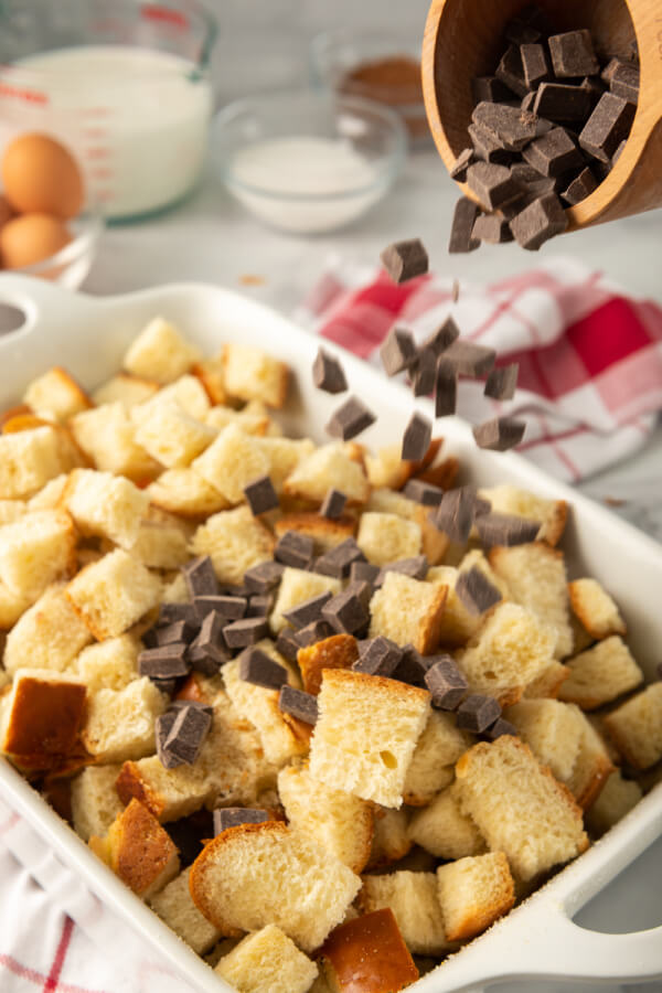 combining the chocolate chips and bread cubes in a casserole dish
