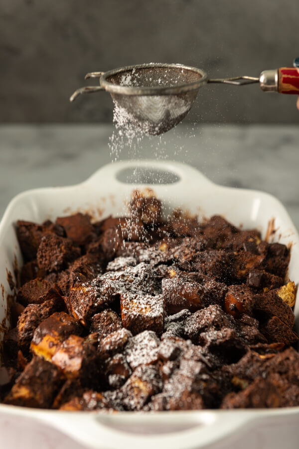 dusting powdered sugar over the top of the finished chocolate bread pudding
