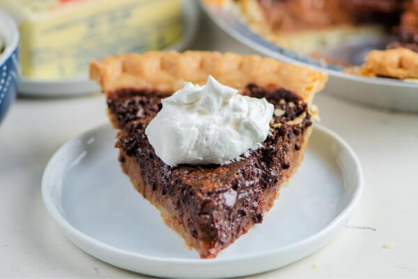slice of chocolate chess pie on white plate
