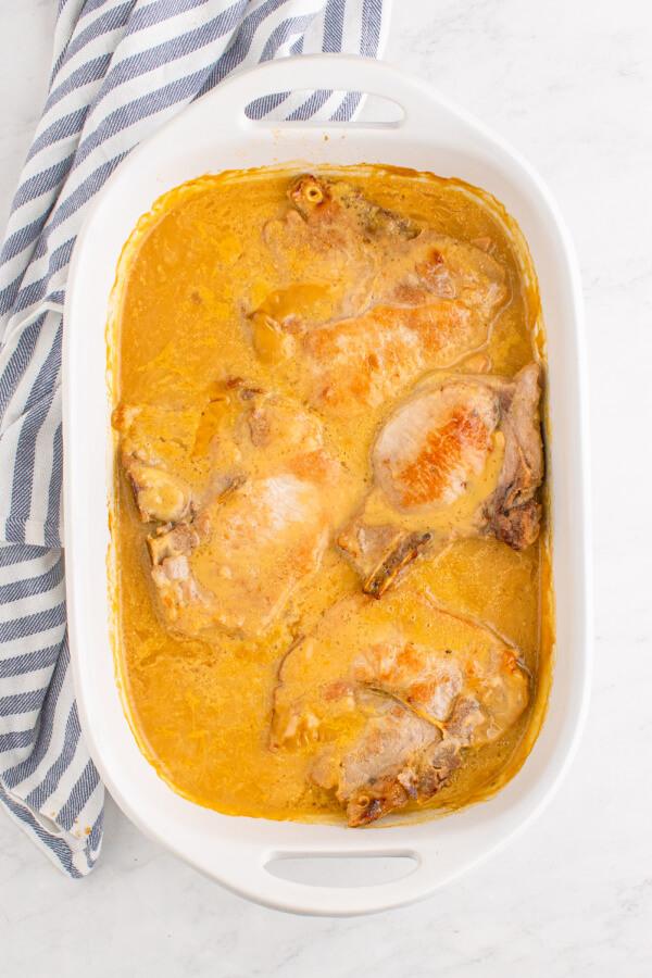 casserole dish with pork chops in gravy