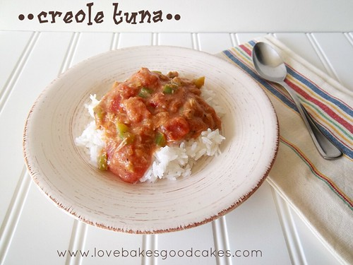 Creole tuna on a white plate with a spoon.