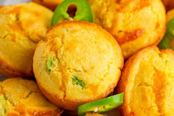 corn muffins stacked on plate