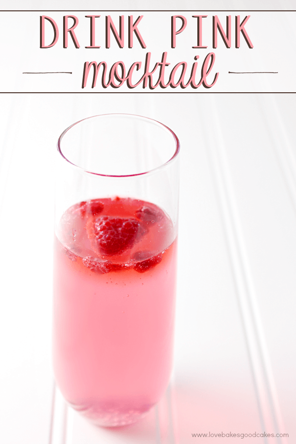 Drink Pink Mocktail in a glass with fresh strawberries.