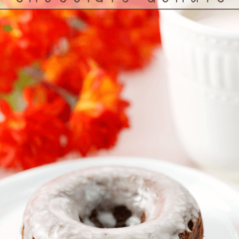 Glazed Chocolate Donuts on a white plate.