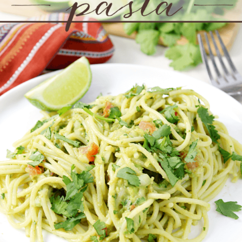 Guacamole Pasta on a white plate with a fork.
