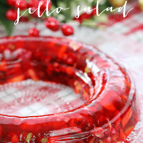 Red Hot Jello Salad on a clear cake plate.