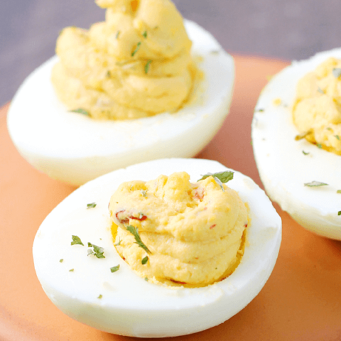 Chipotle Deviled Eggs on a cutting board.