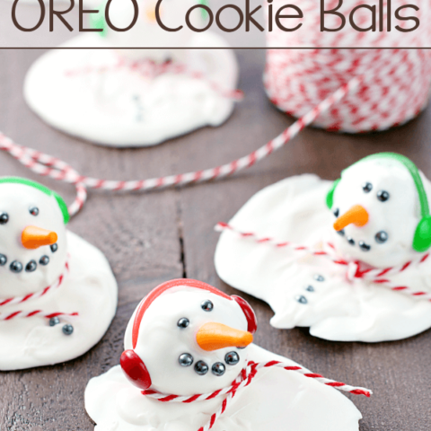Melting Snowman OREO Cookie Balls laying on a cutting board.
