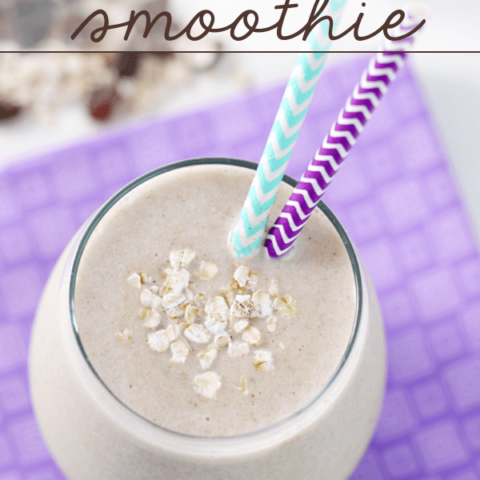 Banana Bread Smoothie in a glass with two straws.