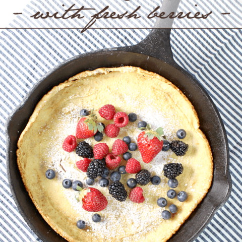 Dutch Baby Pancake with Fresh Berries in a skillet.