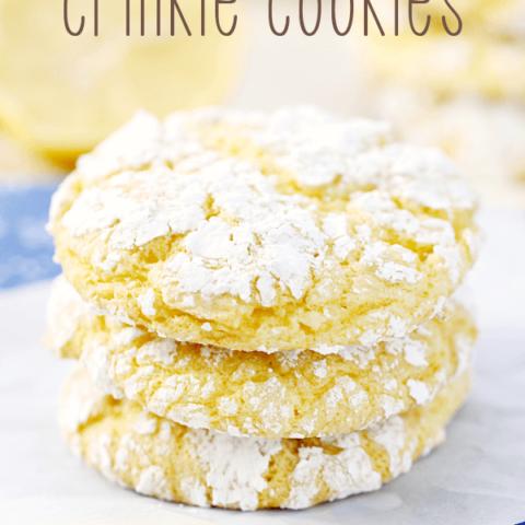 Lemon Crinkle Cookies stacked up on wax paper.