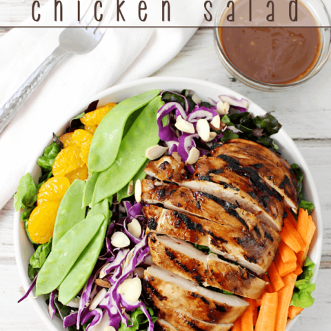 Asian Chicken Salad in a white bowl with a fork.