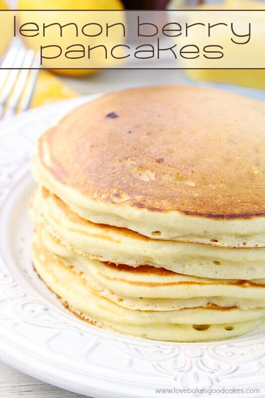 Lemon Berry Pancakes stacked on a white plate.