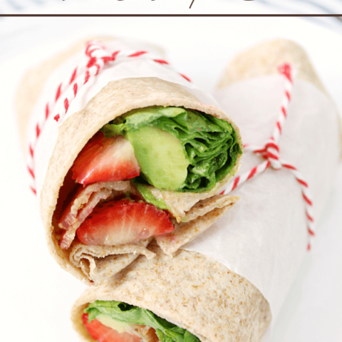 Bacon, Avocado & Strawberry Wraps stacked on a plate.