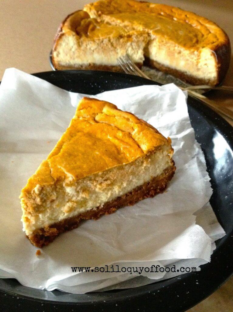 Pumpkin Layer Cheesecake on a plate with a fork.