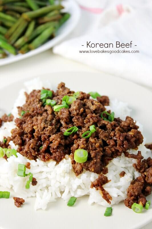 Korean Beef on a white plate with diced green onions.