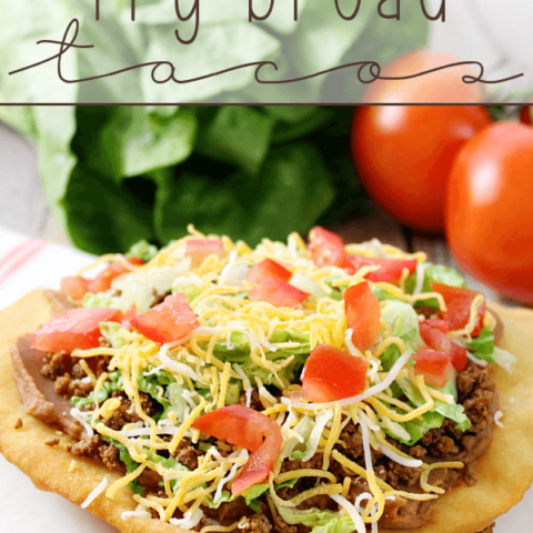 Fry Bread Taco on a white plate with fresh vegetables.