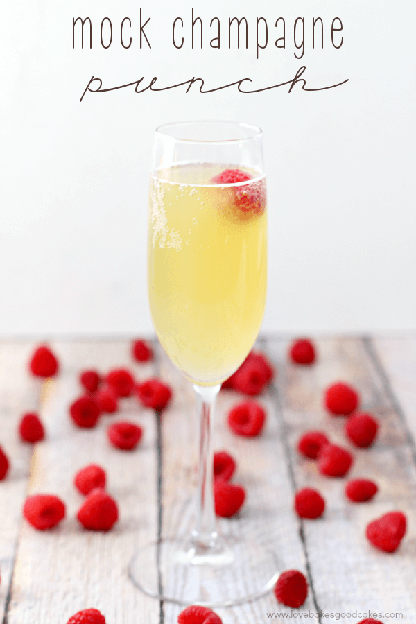 Mock Champagne Punch in a glass with fresh strawberries.
