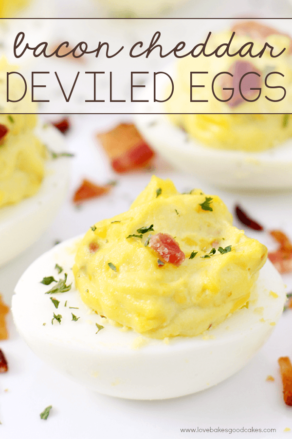 Bacon Cheddar Deviled Eggs on a white plate.