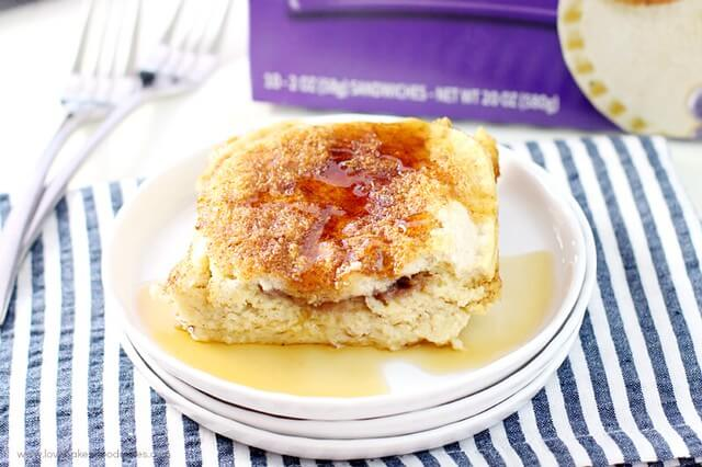 Uncrustables® Overnight French Toast on a white plate with syrup.