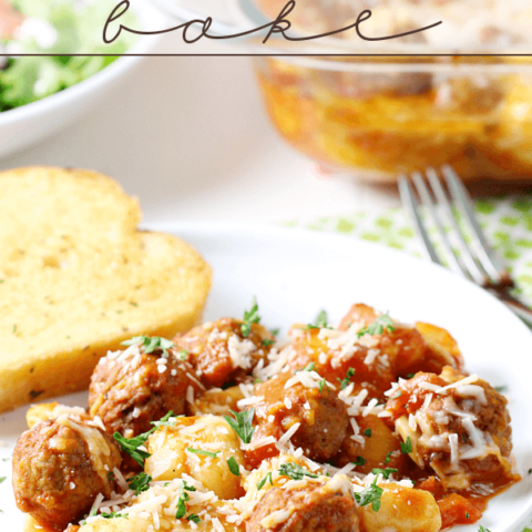 Gnocchi and Meatball Bake on a white plate with French bread and a fork.