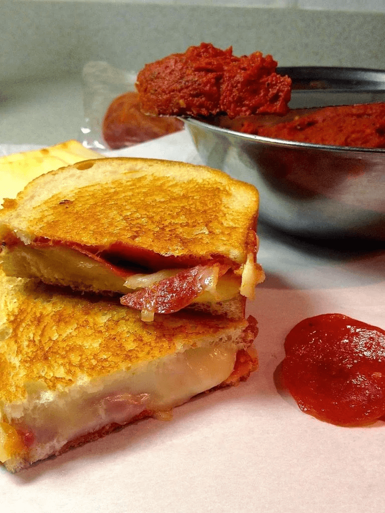 Pepperoni Pizza Grilled Cheese with Pizza Butter on a plate close up.