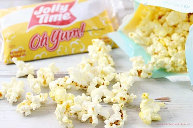 Jolly Time Oh Yum popcorn laying on a cutting board.