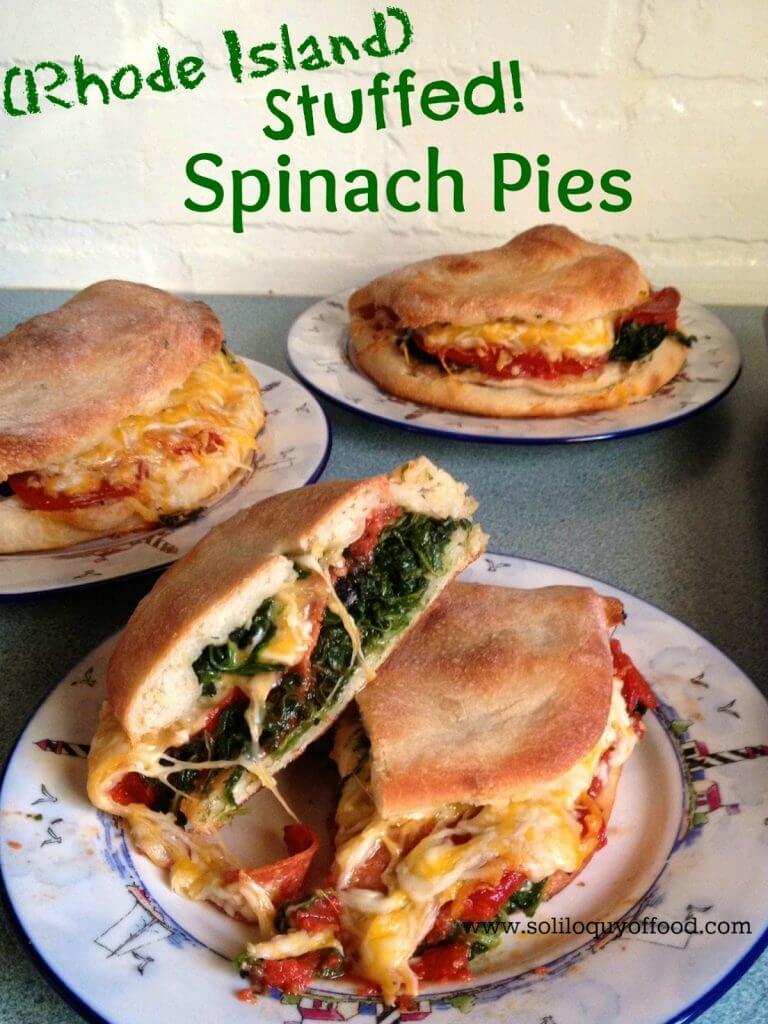 Rhode Island stuffed spinach pies on three plates.