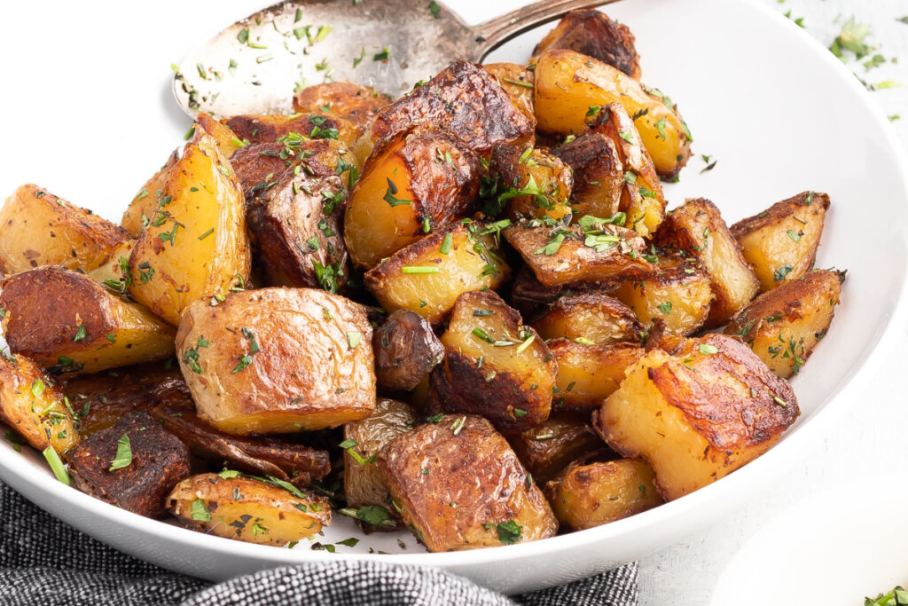 crispy roasted potatoes in serving bowl