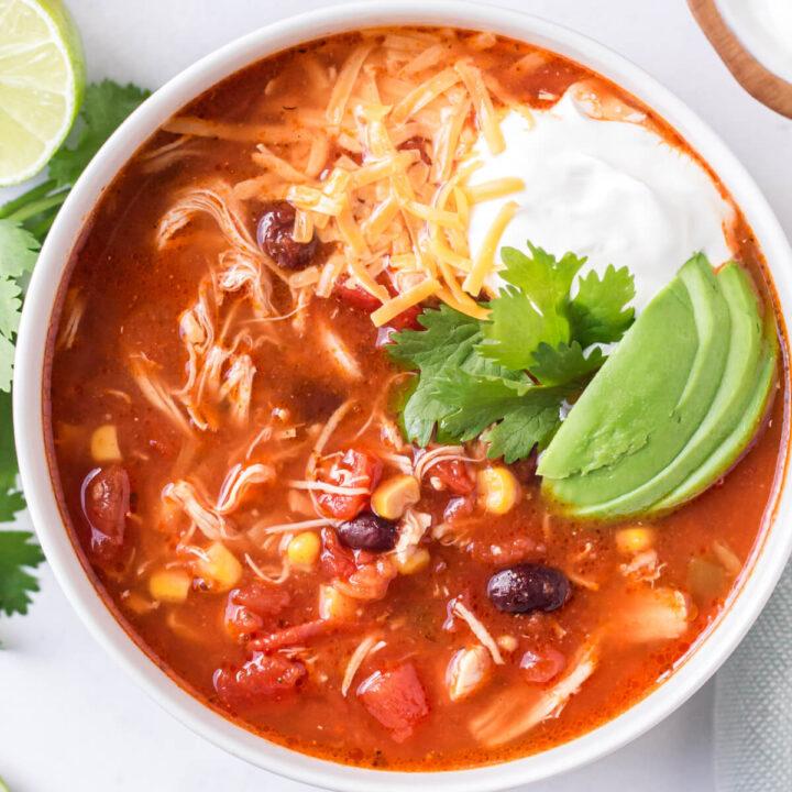 closeup of enchilada soup in white bowl