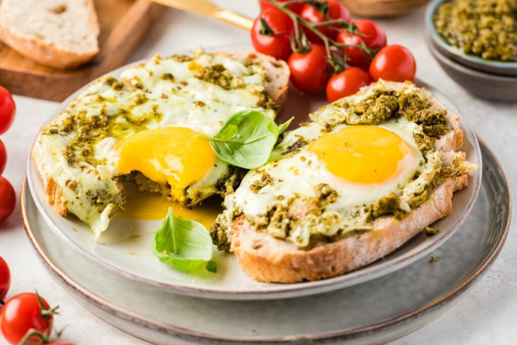 pesto eggs on toast on plate
