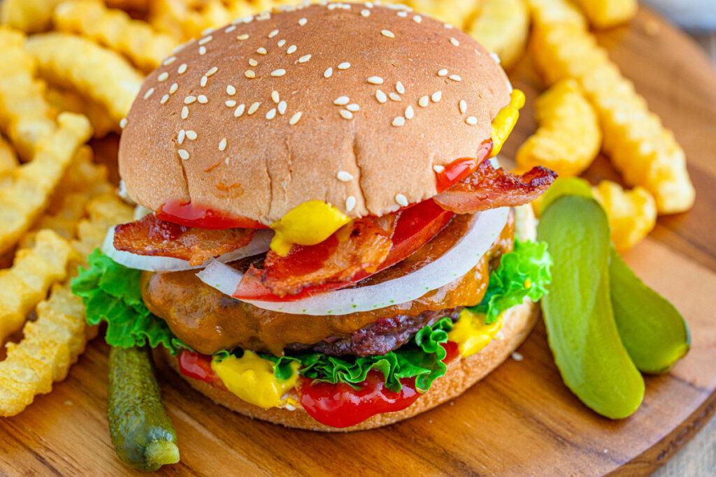 closeup of venison burger on wooden cutting board
