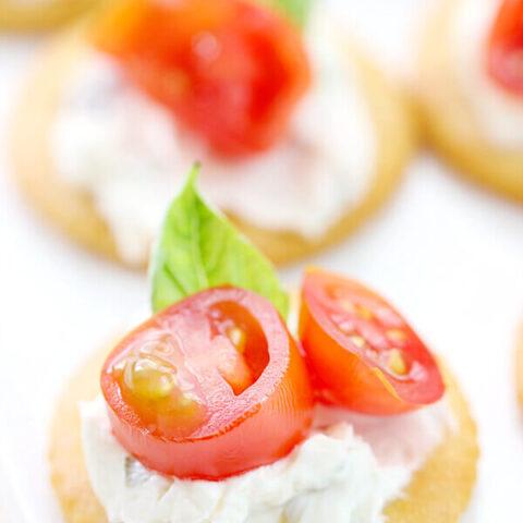 Tomato & Basil RITZwiches on a white platter.