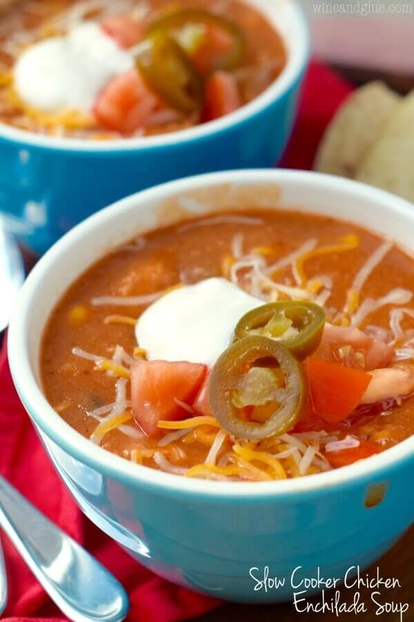 Slow cooker chicken enchilada soup in a blue bowl.